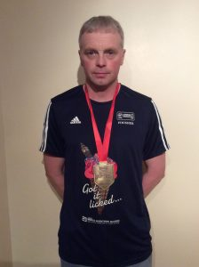 Orkney Athletic Club Senior Member, Gary Tait with his London Marathon finisher's medal